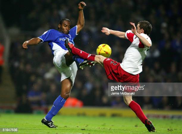 Fabian Wilnis of Ipswich tackles Alan Quinn of Sheffield United during the Coca Cola League Championship match between Ipswich Town and Sheffield...