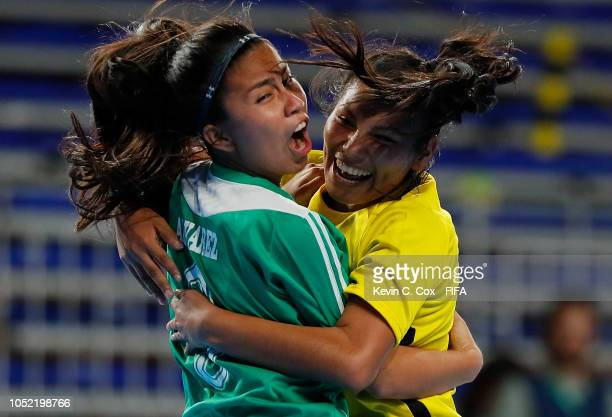Fabiana Alvarez of Bolivia celebrates scoring the second goal against Portugal with Michelle Pacheco in the Women's Futsal semifinal match between...
