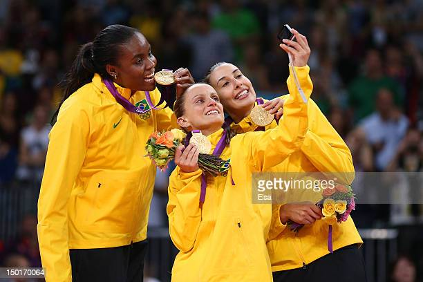 Fabiana Claudino Fabiana Oliveira and Sheilla Castro of Brazil pose for a photo with their medals after defeating the United States to win the...