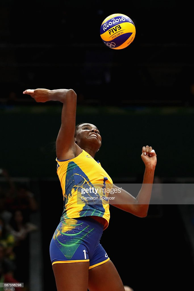Fabiana Claudino of Brazil plays a shot during the Women's Preliminary Pool A match between Argentina and Brazil on Day 3 of the Rio 2016 Olympic Games at the Maracanazinho on August 8, 2016 in Rio de Janeiro, Brazil.