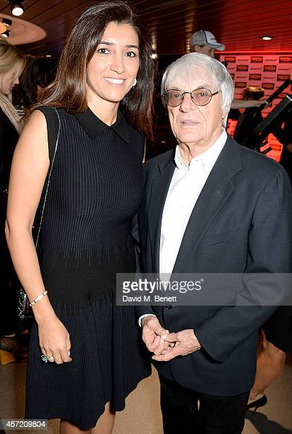 Fabiana Flosi and Bernie Ecclestone attend Technogym McLaren Celebrate 10 Years of Partnership at the McLaren Showroom on October 14 2014 in London...