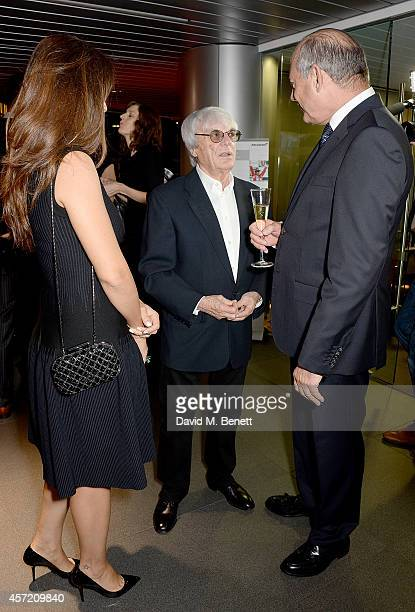 Fabiana Flosi Bernie Ecclestone and Ron Dennis attend Technogym McLaren Celebrate 10 Years of Partnership at the McLaren Showroom on October 14 2014...