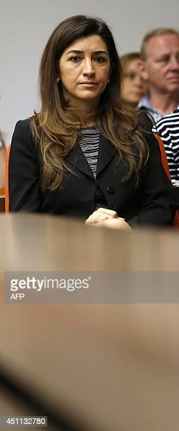 Fabiana Flosi wife of Formula One chief executive Bernie Ecclestone sits in a courtroom in Munich on June 24 2014 Ecclestone is accused of bribing...