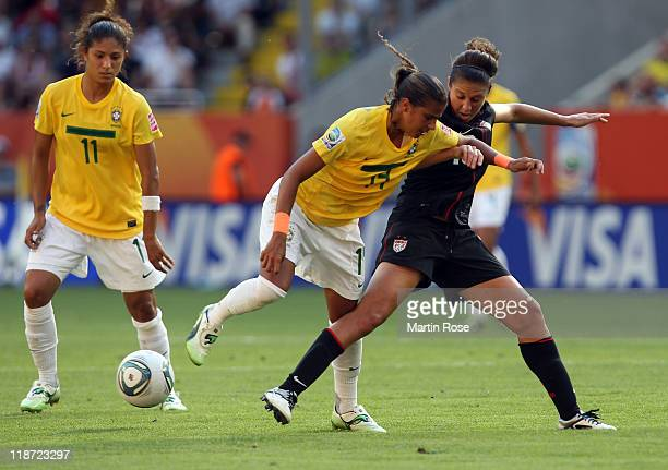 Fabiana of Brazil and Carli Lloyd of USA battle for the ball during the FIFA Women's World Cup 2011 Quarter Final match between Brazil and USA at...
