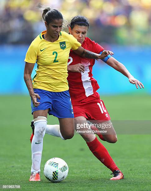 Fabiana of Brazil and Christine Sinclair of Canada challenge for the ball during the Women's Olympic Football Bronze Medal match between Brazil and...