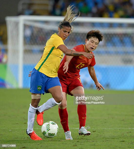Fabiana of Brazil is challenged by Fengyue Pang of China during the Women's Group E first round match between Brazil and China PR during the Rio 2016...
