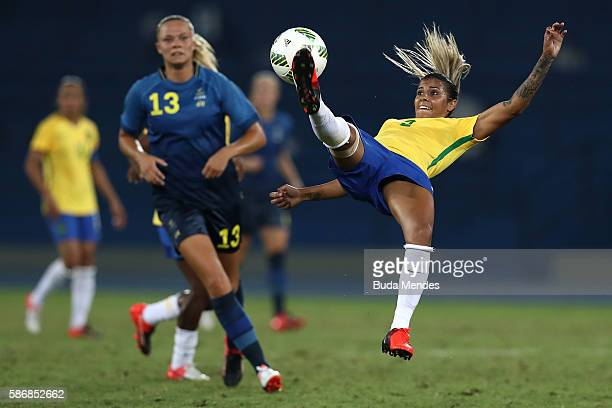Fabiana of Brazil jumps for the ball while Fridolina Rolfo of Sweden looks on during the Women's Group E first round match between Brazil and Sweden...