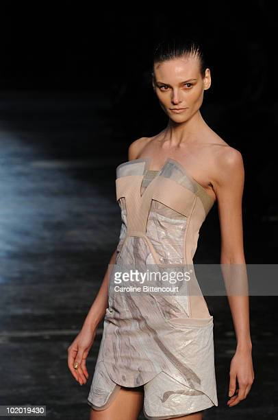 Fabiana Semprebom displays a design by Animale during the fourth day of the Sao Paulo Fashion Week Summer 2011 at the Ibirapuera's Bienal Pavilion on...