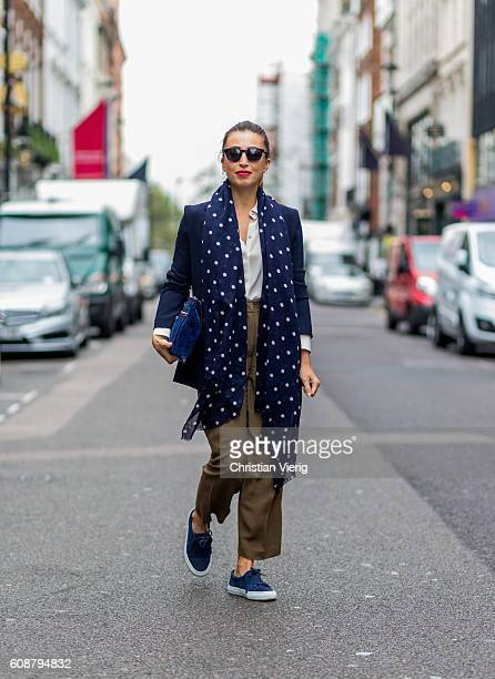 Fabiana Spinelli wearing a blue scarf clutch and blazer and khaki pants during London Fashion Week Spring/Summer collections 2017 on September 19...