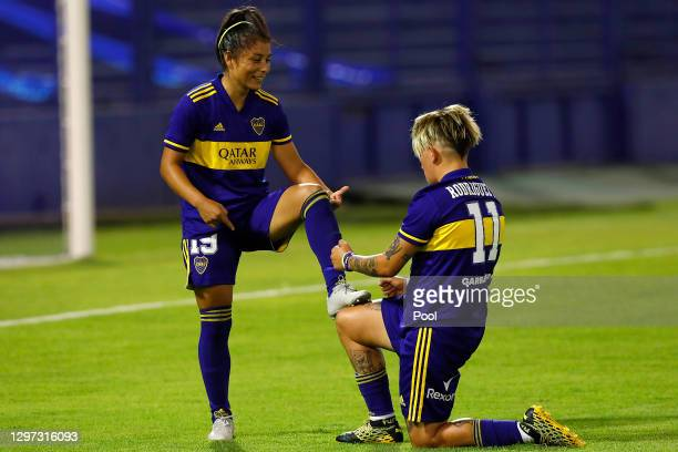 Fabiana Vallejos of Boca Juniors celebrates with teammate Yamila Rodriguez after scoring the seventh goal of his team during the final match between...