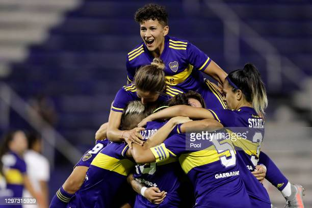 Fabiana Vallejos of Boca Juniors celebrates with teammates after scoring the seventh goal of his team during the final match between Boca Juniors and...