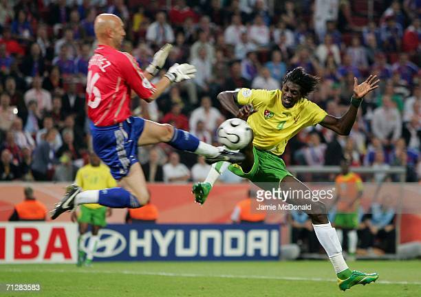 Fabien Barthez of France and Emmanuel Adebayor of Togo challenge for the ball during the FIFA World Cup Germany 2006 Group G match between Togo and...