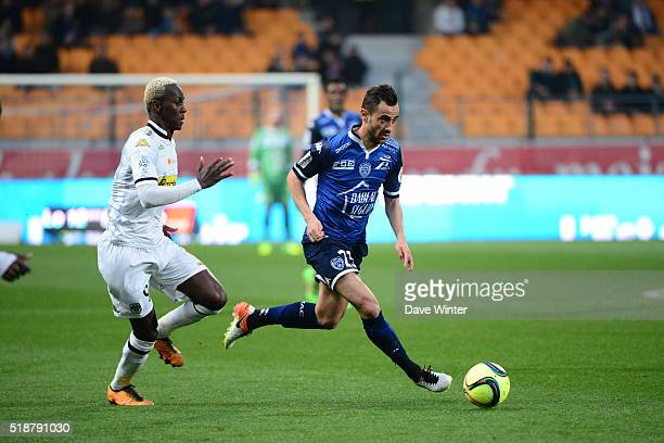 Fabien Camus of Troyes and Mohamed Yattara of Angers during the French Ligue 1 match between ESTAC Troyes and Angers SCO on April 2 2016 in Troyes...