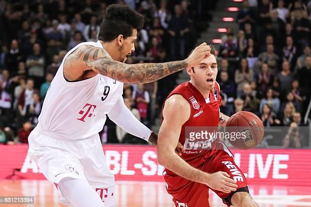 Fabien Causer of Brose Bamberg is challenged by Julian Gamble of Telekom Baskets Bonn during the BBL Bundesliga match between Telekom Baskets Bonn...