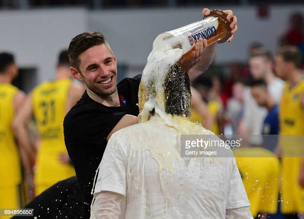 Fabien Causeur of Bamberg is showering Andrea Trinchieri with beer game 3 of the 2017 BBL Finals at Brose Arena on June 11 2017 in Bamberg Germany