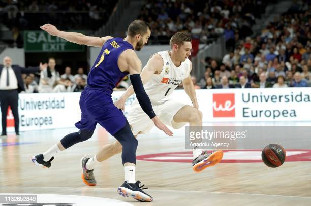 Fabien Causeur of Real Madrid in action against Pau Ribas of Barcelona Lassa during the Liga Endesa week 24 match between Real Madrid and FC...