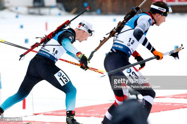 Fabien Claude of France in action, Julian Eberhard of Austria in action during the IBU Biathlon World Cup Men's 15 km Mass Start Competition on...