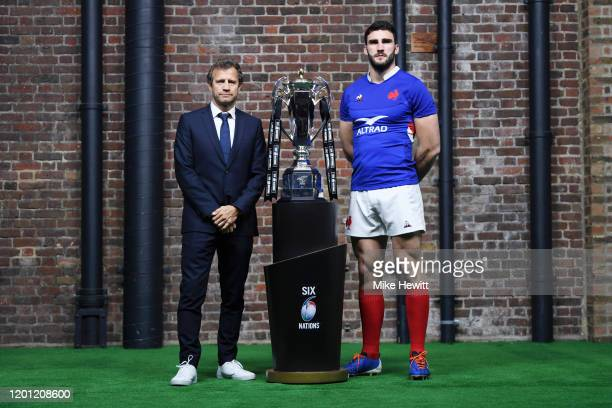Fabien Galthie Head Coach of France and Charles Ollivon Captain of France pose with Six Nations trophy during the Guinness Six Nations Launch at...