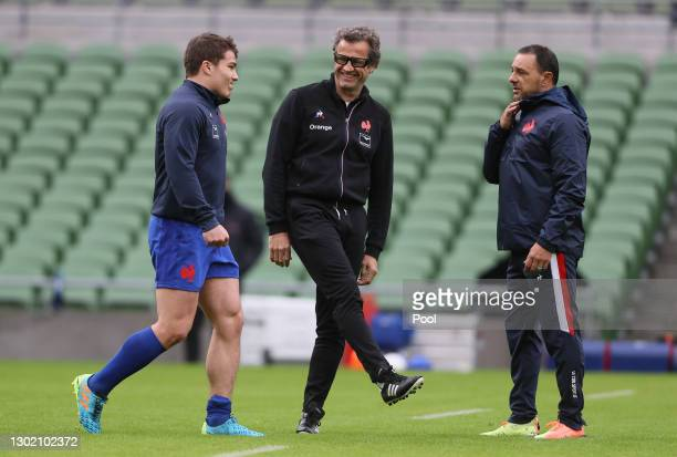 Fabien Galthie, Head Coach of France talks to Antoine Dupont of France prior to the Guinness Six Nations match between Ireland and France at Aviva...