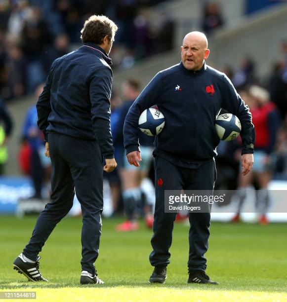 Fabien Galthie the head coach of France looks on his defence coach Shaun Edwards during the 2020 Guinness Six Nations match between Scotland and...