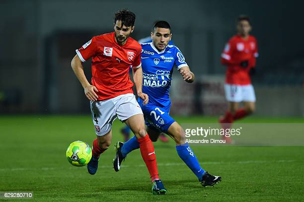 Fabien Garcia of Nimes and Neal Maupay of Brest during the French LIgue 2 match between Nimes and Brest at Stade des Costieres on December 9 2016 in...