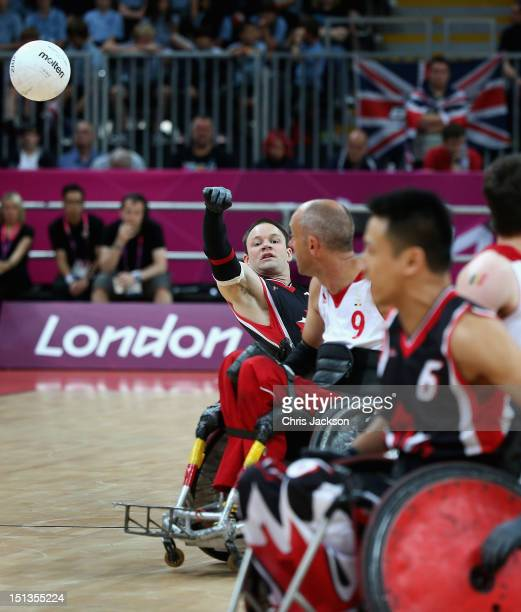 Fabien Lavoie of Canada throws the ball as Belgium play Canada during a Paralympic Wheelchair Rugby match on day 8 of the London 2012 Paralympic...