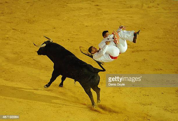 Fabien Napias and Guillaume Vergonzeanne of the French Recortadores company Passion Saltador somersault over a charging bull at the end of the Liga...