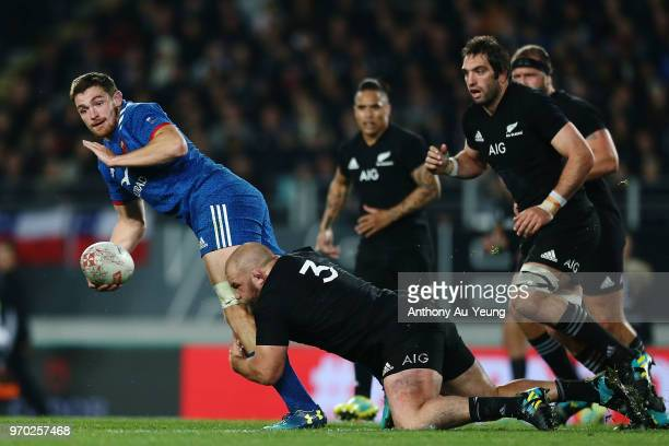 Fabien Sanconnie of France is tackled by Owen Franks of the All Blacks during the International Test match between the New Zealand All Blacks and...