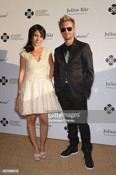 Fabienne Carat and Philippe Lacheau attend the Leonardo Dicaprio Gala at Domaine Bertaud Belieu on July 23 2014 in SaintTropez France