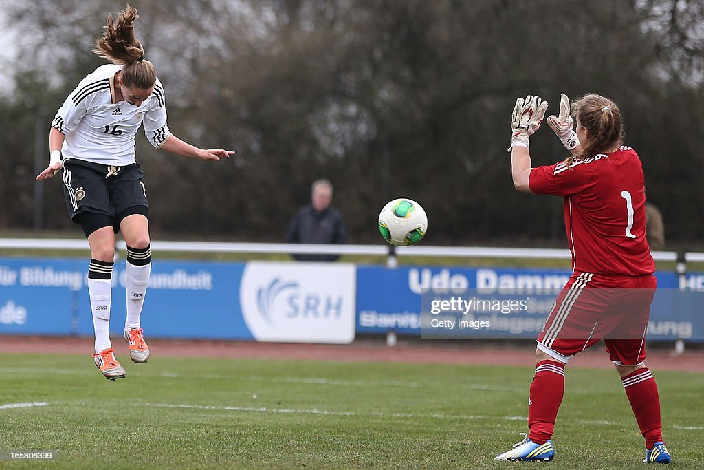 Fabienne Dongus (L) of Germany scores her team's seventh goal against goalkeeper Anthi Papakonstantinou of Greece during the Women's UEFA U19 Euro Qualification match between U19 Germany and U19 Greece at Sportzentrum Sued on April 6, 2013 in Kirchheim, Germany.