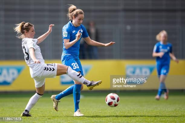 Fabienne Dongus of Hoffenheim is challenged by Desiree van Lunteren of Freiburg during the Women's DFB Cup Semi Final between TSG Hoffenheim and SC...