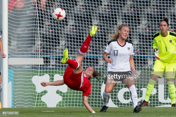 Fabienne Humm of Switzerland and Sarah Puntigam of Austria battle for the ball during the Group C match between Austria and Switzerland during the...