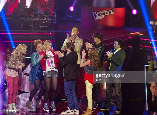 Fabienne of the team of Angela Groothuizen is congratulated by participants and members of the jury after winning the live final of The Voice Kids in...