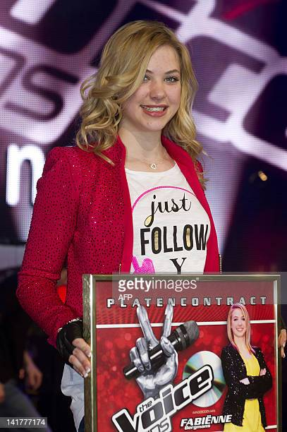 Fabienne of the team of Angela Groothuizen poses after winning the live final of The Voice Kids in Aalsmeer on March 23 2012 AFP PHOTO/ ANP/ KIPPA...