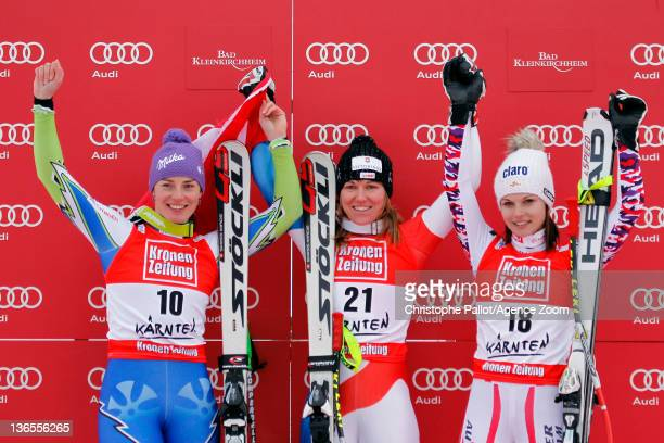 Fabienne Suter of Switzerland takes 1st place Tina Maze of Slovenia takes 2nd place Anna Fenninger of Austria takes 3rd place during the Audi FIS...