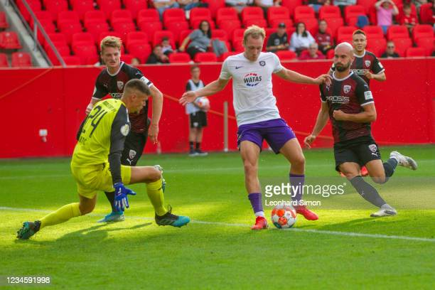 Fabijan Bunti of FC Ingolstadt 04 and Ben Zolinski of Erzgebirge Aue in action during the DFB Cup first round match between FC Ingolstadt 04 and...
