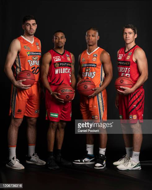 Fabijan Krslovic of the Taipans, Bryce Cotton of the Wildcats, Scott Machado of the Taipans and Damian Martin of the Wildcats pose during the 2020...