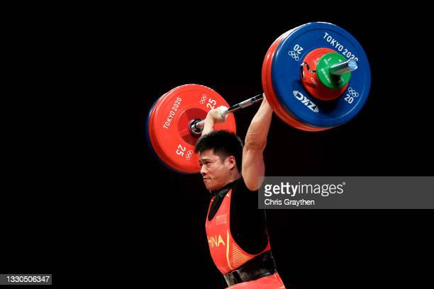 Fabin Li of Team China competes during the Weightlifting - Men's 61kg Group A on day two of the Tokyo 2020 Olympic Games at Tokyo International Forum...