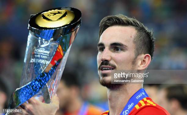Fabián Ruiz of Spain celebrates the victory with the trophy at the end the 2019 UEFA U21 Final between Spain and Germanyat Stadio Friuli on June 30...
