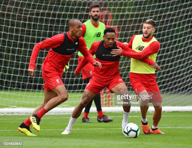 Fabinho Adam Lallana and Nathaniel Clyne of Liverpool during a training session at Melwood Training Ground on August 28 2018 in Liverpool England