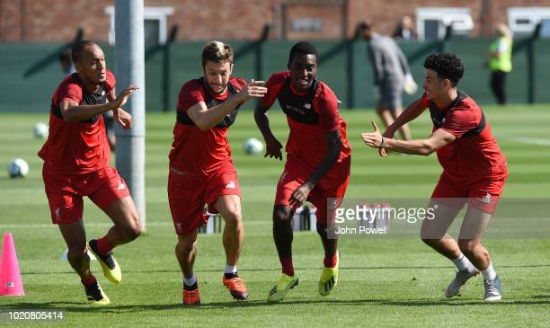 Fabinho Adam Lallana Rafael Camacho and Curtis Jones of Liverpool during a training session at Melwood Training Ground on August 21 2018 in Liverpool...