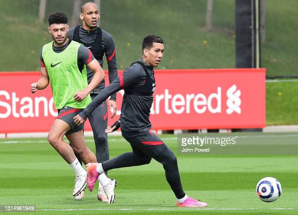Fabinho, Alex Oxlade-Chamberlain and Roberto Firmino of Liverpoolduring a training session at AXA Training Centre on April 28, 2021 in Kirkby,...