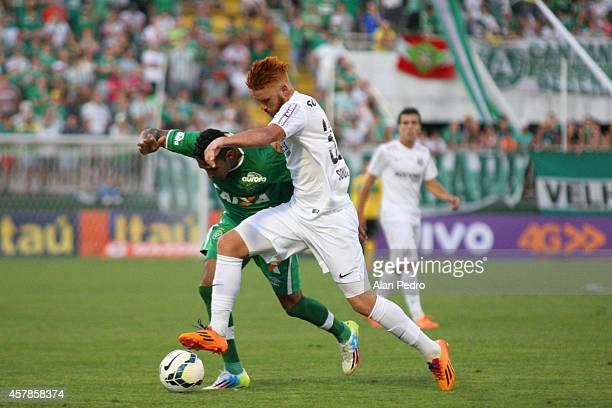 Fabinho Alves of Chapecoense struggles for the ball with Souza of Santos during a match between Chapecoense and Santos for the Brazilian Series A...