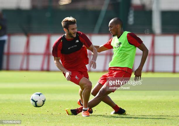 Fabinho and Adam Lallana of Liverpool during a training session at Melwood Training Ground on August 21 2018 in Liverpool England