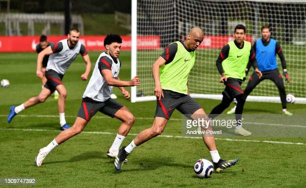 Fabinho and Alex Oxlade-Chamberlain of Liverpool during a training session at AXA Training Centre on March 29, 2021 in Kirkby, England.