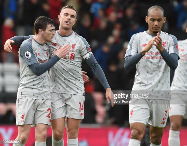 Fabinho and Jordan Henderson of Liverpool and Andrew Robertson at the end of the Premier League match between AFC Bournemouth and Liverpool FC at...