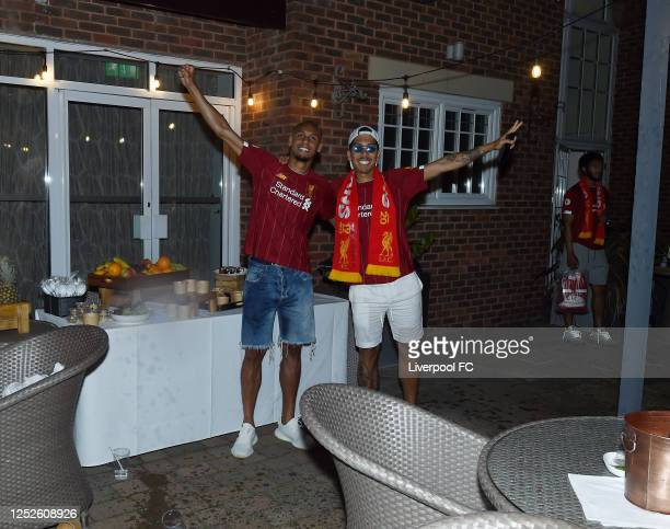 Fabinho and Roberto Firmino of Liverpool celebrating winning the Premier League on June 25, 2020 in Liverpool, England.