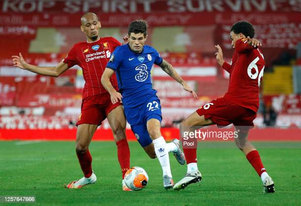 Fabinho and Trent Alexander-Arnold of Liverpool battle for possession with Christian Pulisic of Chelsea during the Premier League match between...