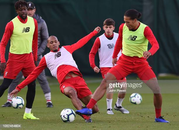 Fabinho and Virgil van Dijk of Liverpool during a training session at Melwood Training Ground on October 18 2018 in Liverpool England