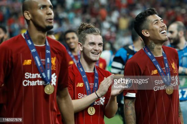 Fabinho Harvey Elliott and Roberto Firmino of Liverpool celebrate victory during the UEFA Super Cup match between Liverpool and Chelsea on August 14...
